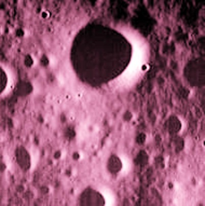 This Wednesday, April 29, 2015 photo provided by NASA shows one of the last images sent by the Messenger spacecraft which is expected to impact the surface of the planet Mercury on Thursday, April 30, 2015. The largest crater in this image has a diameter of 330 meters (0.2 miles). (NASA, Johns Hopkins University Applied Physics Laboratory, Carnegie Institution of Washington via AP)